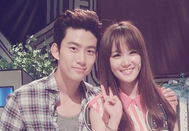 "Taecyeon Uses ""Manner Legs"" in a Candid Photo With Kim Ji Min"
