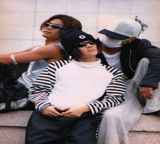 """Seo Taiji and Boys during """"Come Back Home"""" promotions, Yang Hyun Suk on left, Seo Taiji middle, and Lee Juno right."""