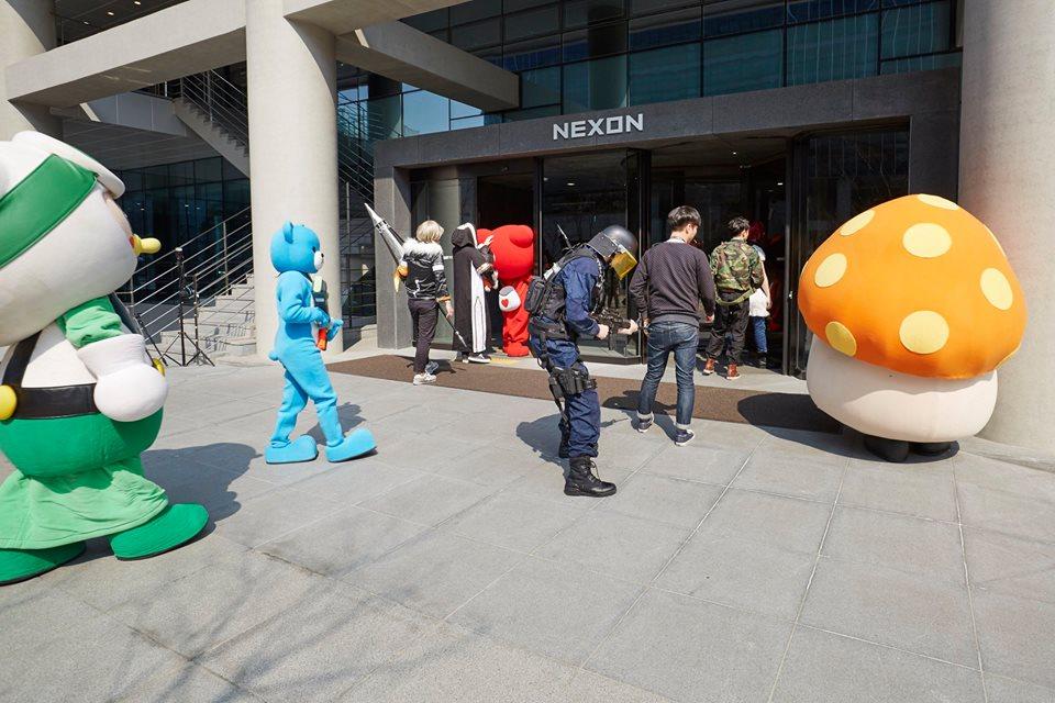 Nexon employees enter the building.
