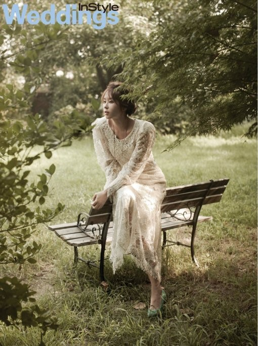 choi kang hee_on a bench