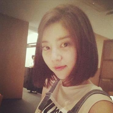 son dam bi cuts off hair