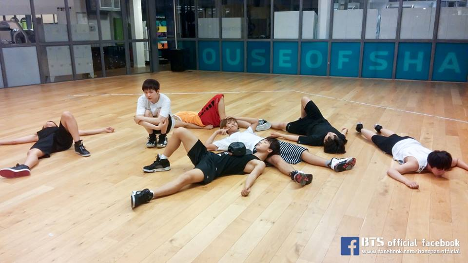 photos of bts hard at work preparing for august comeback