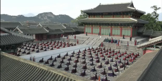 Ministers and Lee Sun kneeling in front of palace
